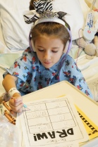 Getting some of her homework done on Surgery Day!